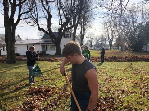 CBI Students Rake Leaves in Community